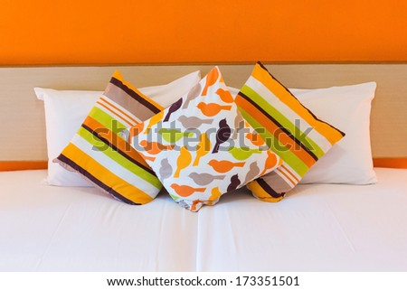 bed with pillows - stock photo
