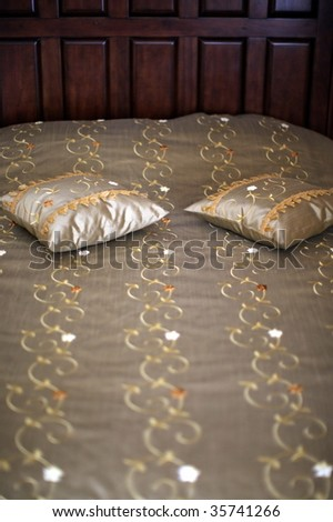 bed with pillows. - stock photo