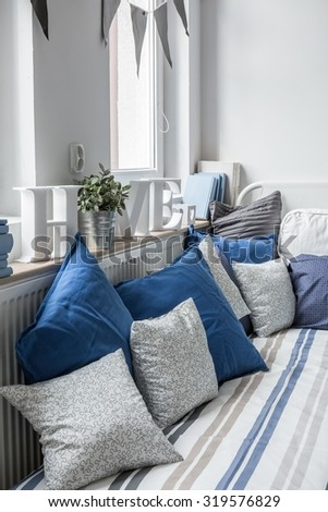 Bed with pillows in the sunny place  - stock photo