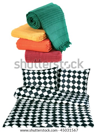 Bedclothes and bedspread isolated on white background - stock photo