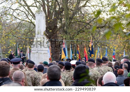 BEDFORD, ENGLAND  NOVEMBER 2014: Remembrance Day Parade - Public and troops paying respects, shown on 9 November 2014 in Bedford - stock photo