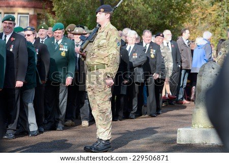 BEDFORD, ENGLAND  NOVEMBER 2014: Remembrance Day Parade - Soldiers with Salvation Army band playing music, shown on 9 November 2014 in Bedford