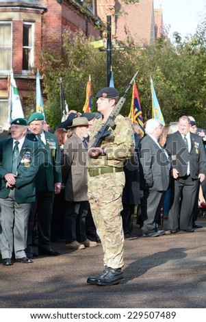 BEDFORD, ENGLAND  NOVEMBER 2014: Remembrance Day Parade - Solider and veterans paying their respects to their fallen comrades, shown on 9 November 2014 in Bedford - stock photo