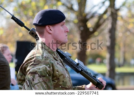 BEDFORD, ENGLAND  NOVEMBER 2014: Remembrance Day Parade - Solider standing to attention, shown on 9 November 2014 in Bedford - stock photo