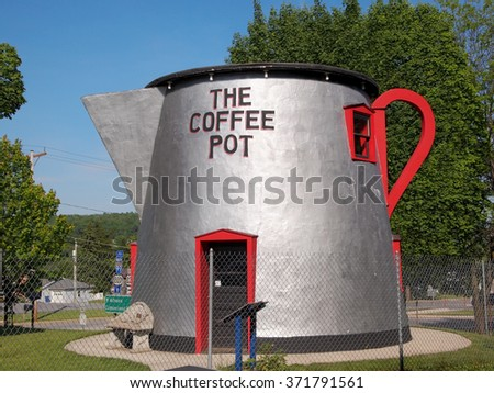 BEDFORD, PENNSYLVANIA - MAY 24, 2015: The Coffee Pot, an 18 ft tall coffee pot shaped building originally built in the 1920's, stands by the side of the road on Lincoln Highway in Bedford, PA.  - stock photo