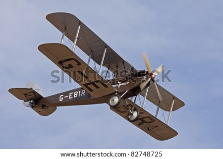 BEDFORDSHIRE, UK - AUGUST 13: De Havilland DH 60 Moth (G-EBIR) in flight at the evening Airshow on August 13, 2011 at Shuttleworth, Old Warden Park, Bedfordshire, UK.