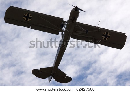 BEDFORDSHIRE, UK - AUGUST 7: 1942 Fieseler Storch (G-STCH) in flight at the Airshow on August 7, 2011 at Shuttleworth, Old Warden Park, Bedfordshire, UK.