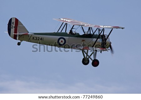 BEDFORDSHIRE, UK - MAY 14: A 1931 Avro Tutor K3241 in flight at the Spring Airshow on May 14, 2011 at Shuttleworth, Old Warden Park, Bedfordshire, UK.