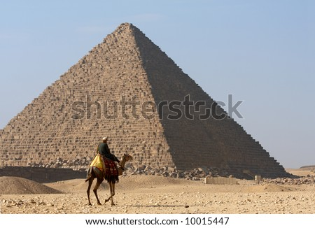 Bedouin on camel near of pyramid in Egypt - stock photo