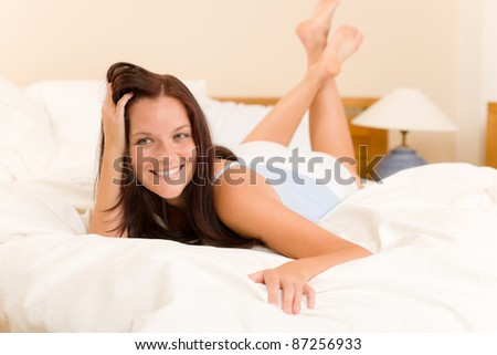 Bedroom - beautiful woman morning waking up lying on white bed