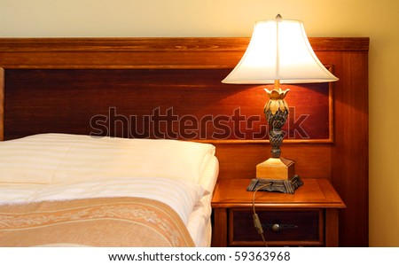Bedroom close up - luxury interior. Conceptual image - a comfortable accommodation metaphor. Great for travel agencies and hotels advertising. - stock photo