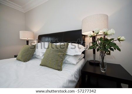 bedroom detail with double bed and bedside tables - stock photo