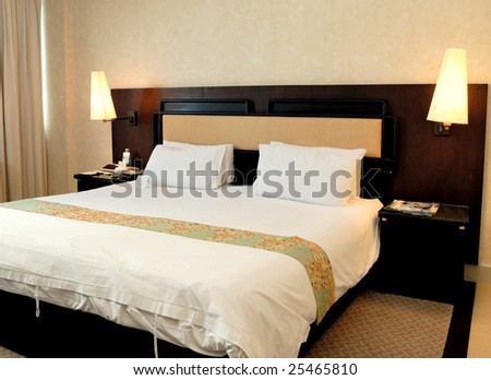 Bedroom in a hotel - stock photo
