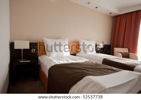 bedroom in a hotel with chair - stock photo