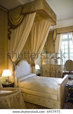Bedroom in Chateau Cheverny Cheverny. Loire Valley, France - stock photo