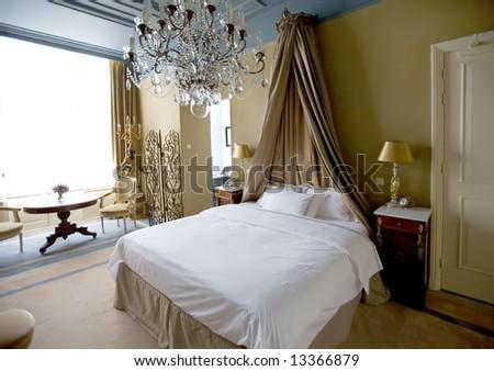 bedroom in hotel - stock photo