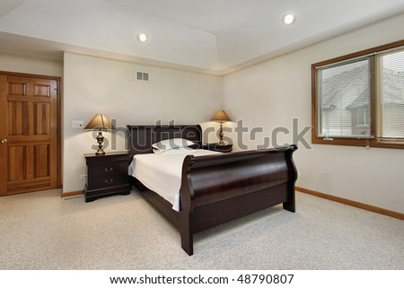 Bedroom in suburban home with tray ceiling - stock photo