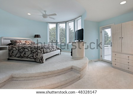 Bedroom in upscale home with step up sleeping area - stock photo