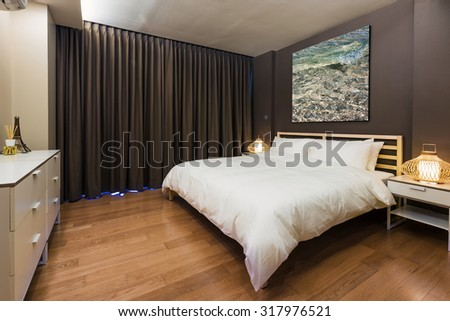 Bedroom interior design. Large bed and Big window with  curtain. Brown Color - stock photo
