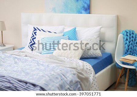 Bedroom interior in light tones with white furniture and pillows - stock photo