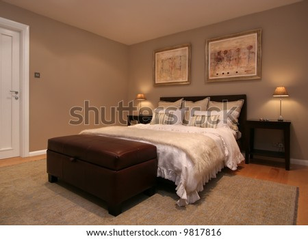 Bedroom interior in modern home - stock photo