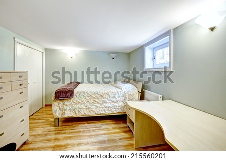 Bedroom interior. Mother-in-law apartment. Furnished with bed, desk and dresser