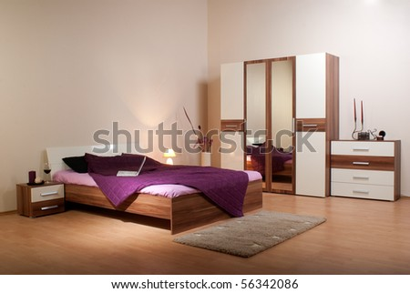 bedroom interior showcase including bed, wardrobe, bedside table commodes, linen-press - stock photo