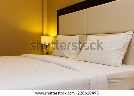 bedroom interior with bed and lamp decoration - stock photo