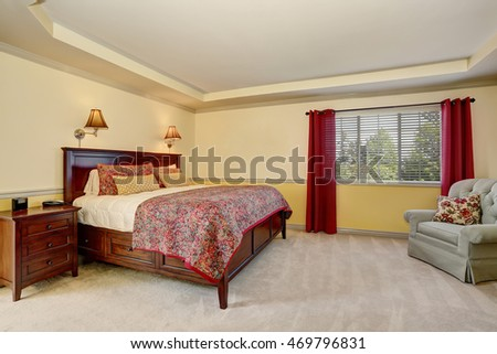 Bedroom interior with deep brown furniture and red curtains. Northwest, USA