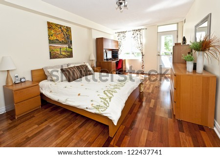 Bedroom interior with hardwood floor - artwork is from photographer portfolio - stock photo