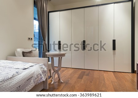 Bedroom interior with large closet - stock photo