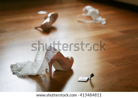 Bedroom mess with lingerie, shoes and condom, quick sex concept