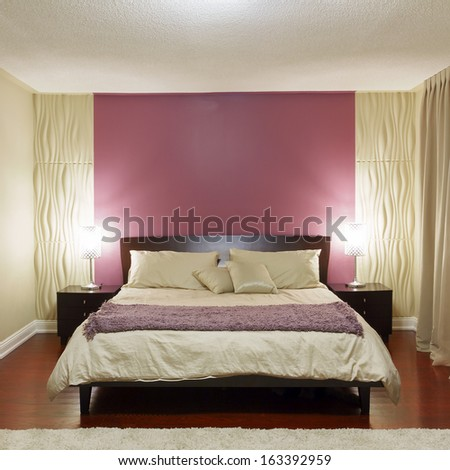 Bedroom modern interior design with furnishings and copyspace on the wall - stock photo