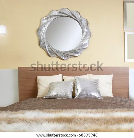 bedroom modern silver mirror fake fur african blanket - stock photo