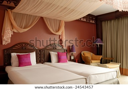Bedroom of a luxury resort - stock photo