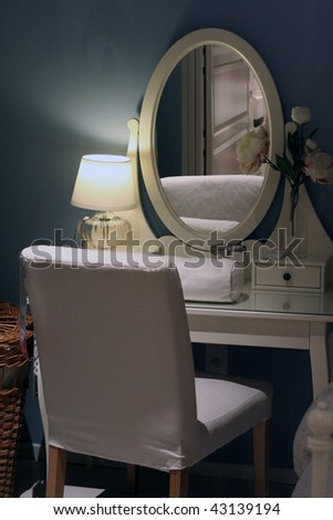 Bedroom with a mirror - stock photo
