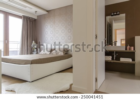 Bedroom with bathroom - stock photo