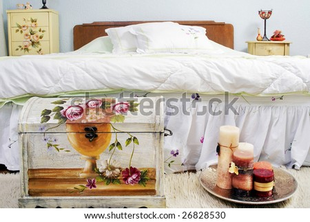 Bedroom with candles and old fashioned box - stock photo