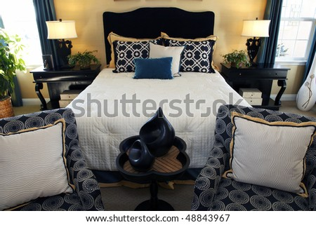 Bedroom with contemporary furniture and stylish decor. - stock photo
