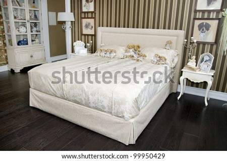 bedroom with large bed and light the night tables and a wardrobe - stock photo