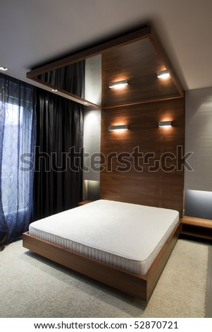 bedroom with mirror on the ceiling - stock photo