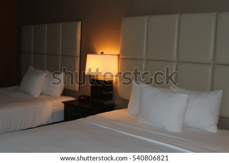 Bedroom with queen size beds at night