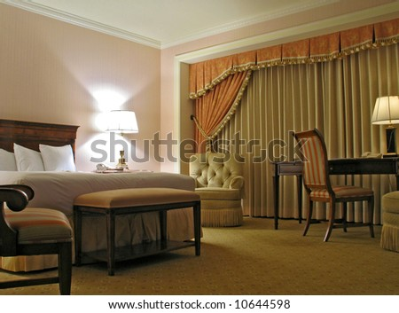 Bedroom with table chairs lamp and curtain - stock photo