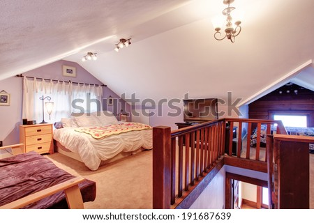 Bedroom with vaulted ceiling and carpet floor.