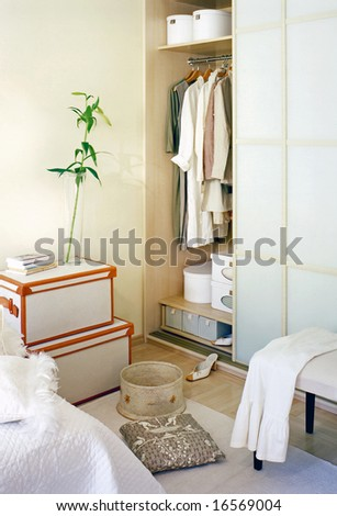 bedroom with view on big wardrobe - stock photo