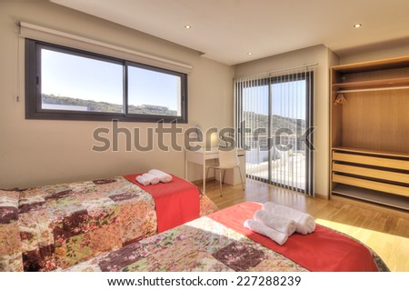 Bedroom with wardrobe and sea view - stock photo