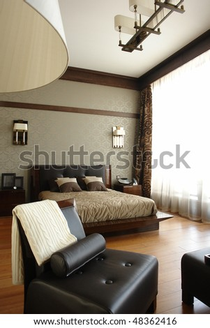 bedroom with wide window - stock photo