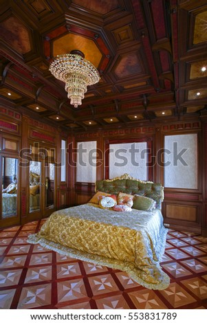 Bedroom wood-paneled.