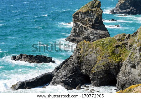 Bedruthan Steps and Samaritan Island viewed from Pendarves Point Cornwall England - stock photo