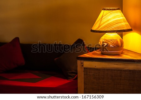 Bedside lamp and sofa in a luxury hotel - stock photo
